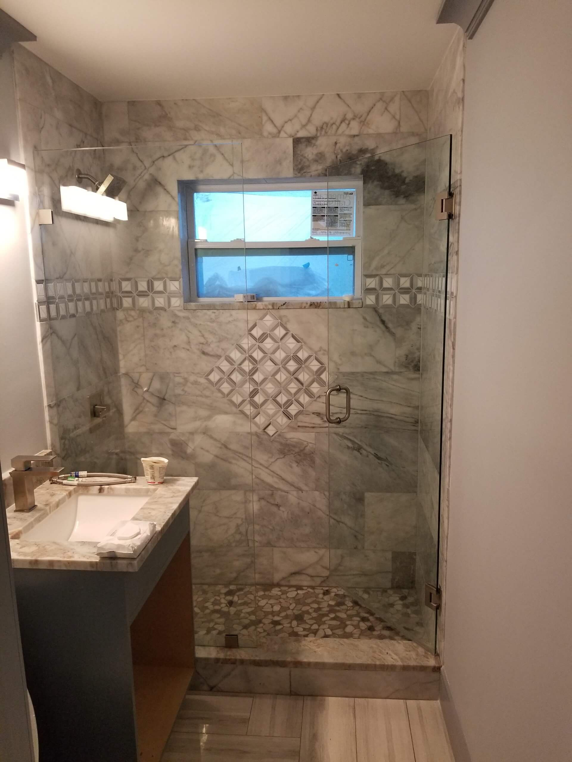 small remodeled shower gray tile