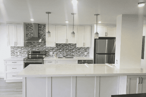 White Cabinets with grey backsplash accent