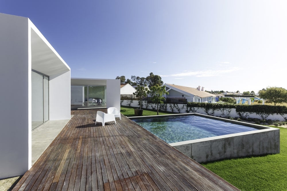 Modern house with garden swimming pool and wooden deck Custom Home Palm Beach County